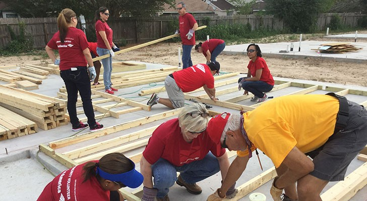 Bank of America employees volunteering to build a house with Habitat for Humanity