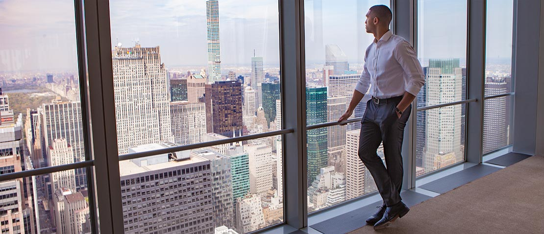 Employee enjoying the view from the New York Office